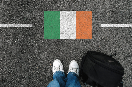 a man with a shoes and flag of Ireland